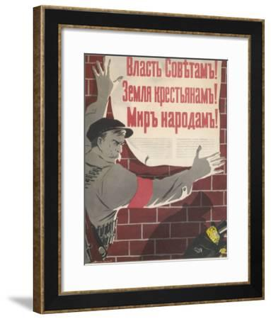Big Brave Communist Worker Fixes a Poster on a Wall--Framed Giclee Print
