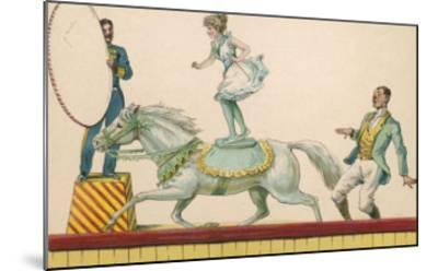 Girl Standing on the Back of a Grey Horse Prepares to Jump Through a Paper Hoop--Mounted Giclee Print