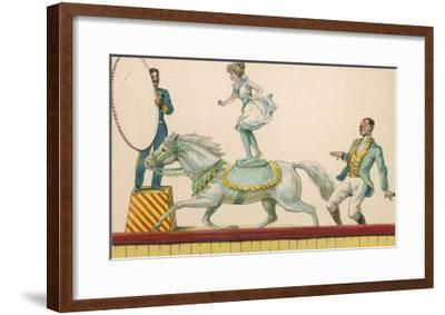 Girl Standing on the Back of a Grey Horse Prepares to Jump Through a Paper Hoop--Framed Giclee Print