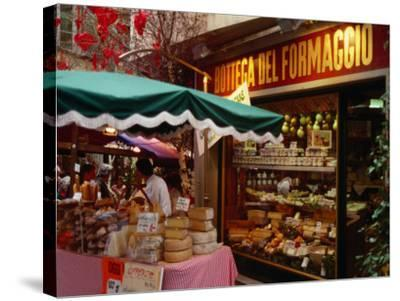 Cheese Stall Outside Cheese Shop on Via Pessina, Lugano, Ticino, Switzerland-Stephen Saks-Stretched Canvas Print
