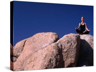 Yoga on the Rocks in the Joshua Tree National Park, California, USA-Cheyenne Rouse-Stretched Canvas Print