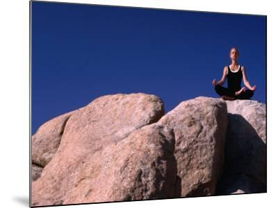 Yoga on the Rocks in the Joshua Tree National Park, California, USA-Cheyenne Rouse-Mounted Photographic Print
