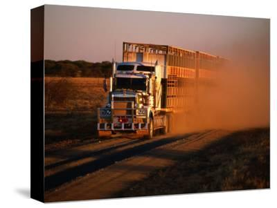 Road Train Driving along Dusty Road, Kynuna, Australia-Holger Leue-Stretched Canvas Print