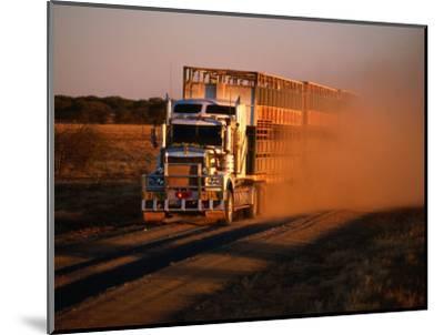 Road Train Driving along Dusty Road, Kynuna, Australia-Holger Leue-Mounted Photographic Print