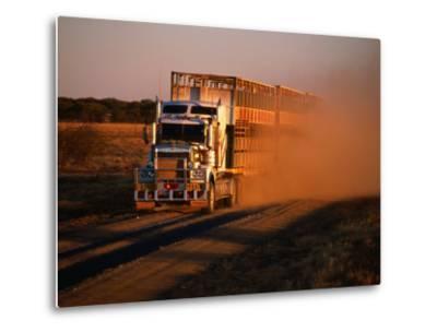 Road Train Driving along Dusty Road, Kynuna, Australia-Holger Leue-Metal Print