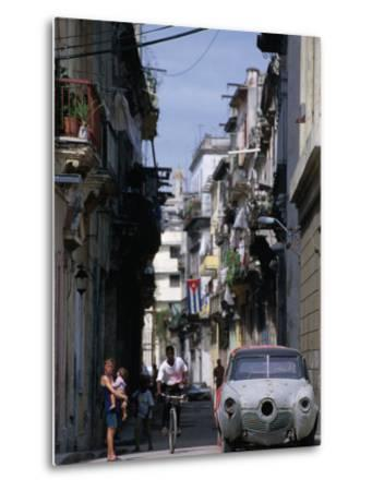 Woman with Baby, Man on Bicycle and Old Car in a Narrow Street Lined with Houses, Havana, Cuba-Rick Gerharter-Metal Print