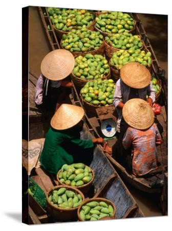 Floating Market along the Mekong Delta, an Giang, Vietnam-John Banagan-Stretched Canvas Print