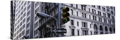 Traffic Light in Front of a Building, Wall Street, New York, USA--Stretched Canvas Print