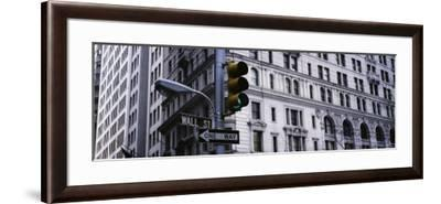 Traffic Light in Front of a Building, Wall Street, New York, USA--Framed Photographic Print