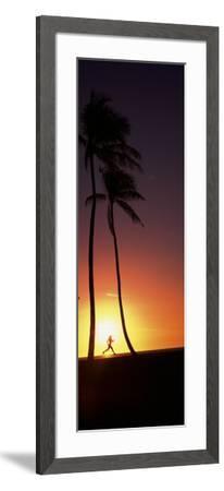 Silhouette of a Woman Running on the Beach, Magic Island, Hawaii, USA--Framed Photographic Print