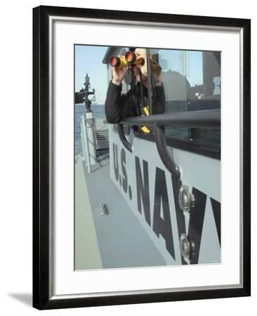 Us Navy Mate Looks Through Binoculars as He Patrols the Coastal Waters of the Persian Gulf-Stocktrek Images-Framed Photographic Print