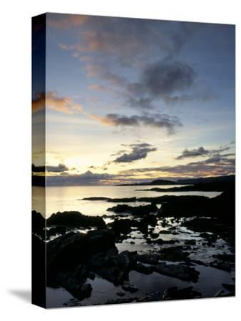 Rocky Coastline at Dusk, Looking Along the Coast to Easdale Island, Seil Island, Scotland-Pearl Bucknall-Stretched Canvas Print