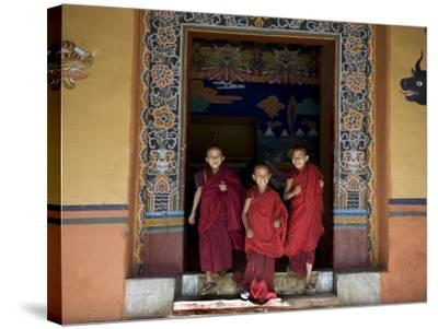 Buddhist Monks, Paro Dzong, Paro, Bhutan-Angelo Cavalli-Stretched Canvas Print