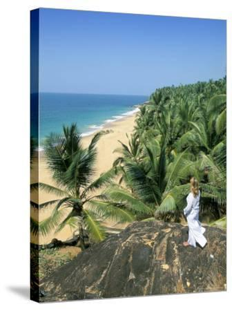 Woman Looking Over Coconut Palms to the Beach, Kovalam, Kerala State, India-Gavin Hellier-Stretched Canvas Print