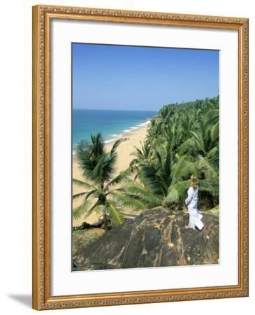 Woman Looking Over Coconut Palms to the Beach, Kovalam, Kerala State, India-Gavin Hellier-Framed Photographic Print