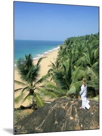 Woman Looking Over Coconut Palms to the Beach, Kovalam, Kerala State, India-Gavin Hellier-Mounted Photographic Print