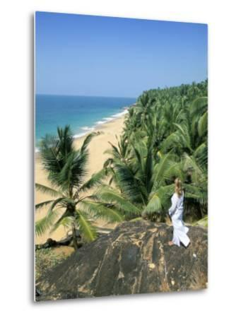 Woman Looking Over Coconut Palms to the Beach, Kovalam, Kerala State, India-Gavin Hellier-Metal Print