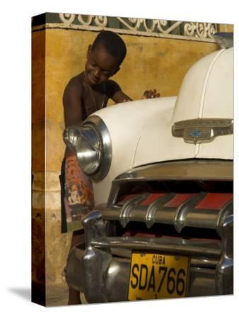 Young Boy Drumming on Old American Car's Bonnet,Trinidad, Sancti Spiritus Province, Cuba-Eitan Simanor-Stretched Canvas Print