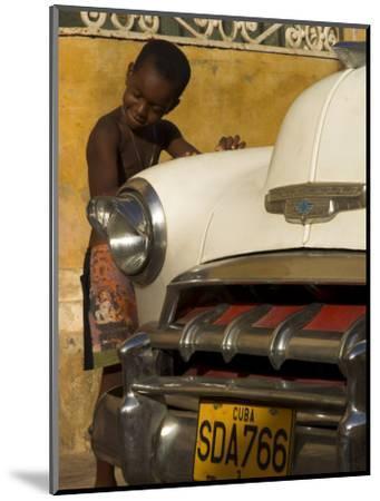 Young Boy Drumming on Old American Car's Bonnet,Trinidad, Sancti Spiritus Province, Cuba-Eitan Simanor-Mounted Photographic Print