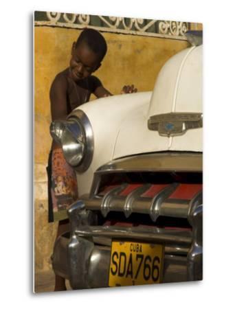 Young Boy Drumming on Old American Car's Bonnet,Trinidad, Sancti Spiritus Province, Cuba-Eitan Simanor-Metal Print