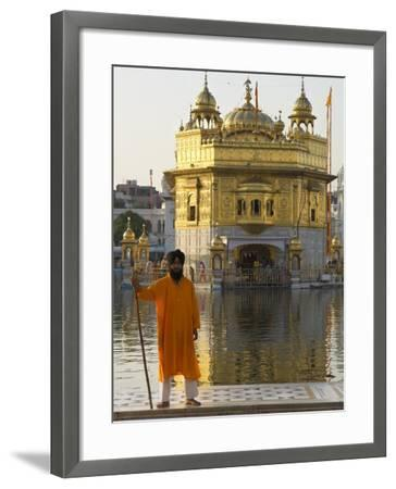 Shrine Guard in Orange Clothes Holding Lance Standing by Pool in Front of the Golden Temple-Eitan Simanor-Framed Photographic Print
