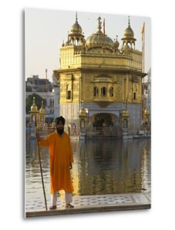 Shrine Guard in Orange Clothes Holding Lance Standing by Pool in Front of the Golden Temple-Eitan Simanor-Metal Print
