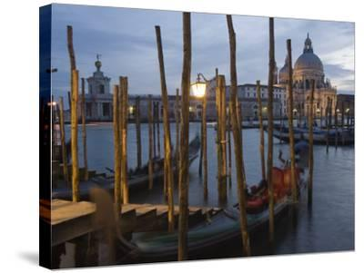 Gondolas on Waterfront at Night, Church Basilica, Venice, Unesco World Heritage Site, Veneto, Italy-Christian Kober-Stretched Canvas Print