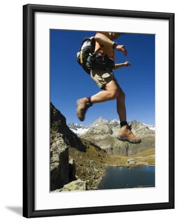 Hiker Running on Trail Above Lake at Schwarzee Paradise, Zermatt Alpine Resort, Valais, Switzerland-Christian Kober-Framed Photographic Print