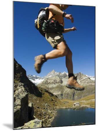 Hiker Running on Trail Above Lake at Schwarzee Paradise, Zermatt Alpine Resort, Valais, Switzerland-Christian Kober-Mounted Photographic Print