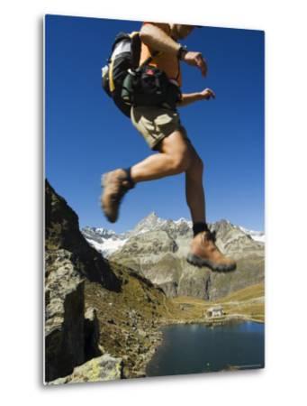 Hiker Running on Trail Above Lake at Schwarzee Paradise, Zermatt Alpine Resort, Valais, Switzerland-Christian Kober-Metal Print