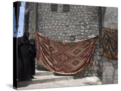 Local Woman Walking Down Steps, Blanket on Wall, Aleppo (Haleb), Syria, Middle East-Christian Kober-Stretched Canvas Print