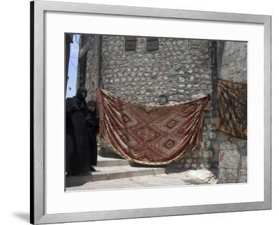 Local Woman Walking Down Steps, Blanket on Wall, Aleppo (Haleb), Syria, Middle East-Christian Kober-Framed Photographic Print