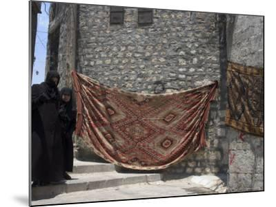 Local Woman Walking Down Steps, Blanket on Wall, Aleppo (Haleb), Syria, Middle East-Christian Kober-Mounted Photographic Print