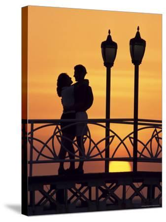 Couple on Bridge, Aruba, West Indies, Dutch Caribbean, Central America-Sergio Pitamitz-Stretched Canvas Print