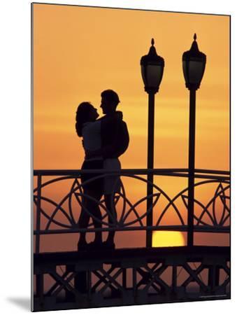 Couple on Bridge, Aruba, West Indies, Dutch Caribbean, Central America-Sergio Pitamitz-Mounted Photographic Print