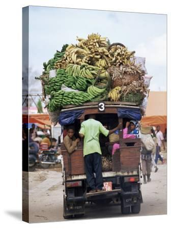 Van Loaded with Bananas on Its Roof Leaving the Market, Stone Town, Zanzibar, Tanzania-Yadid Levy-Stretched Canvas Print