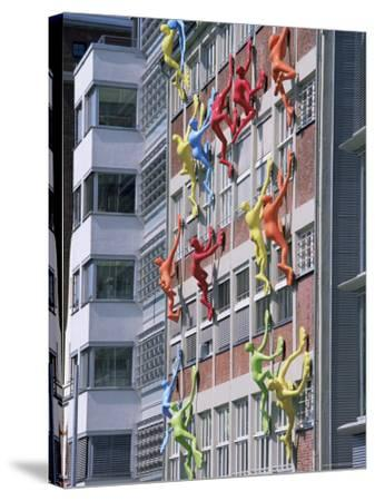 Flossies Figures Covering a Building Facade at the Medienhafen, Dusseldorf, North Rhine Westphalia-Yadid Levy-Stretched Canvas Print