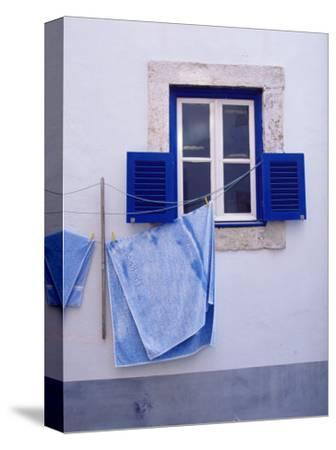 Laundry Hanging on Line at Window in the Moorish Quarter of Alfama, Lisbon, Portugal-Yadid Levy-Stretched Canvas Print