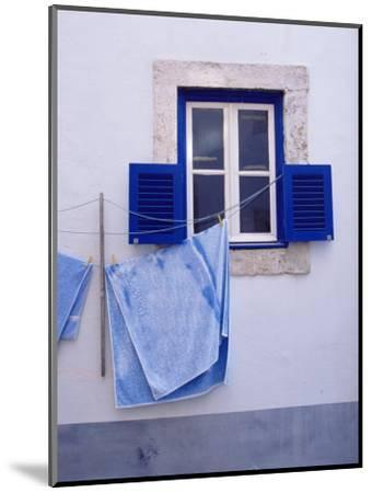 Laundry Hanging on Line at Window in the Moorish Quarter of Alfama, Lisbon, Portugal-Yadid Levy-Mounted Photographic Print
