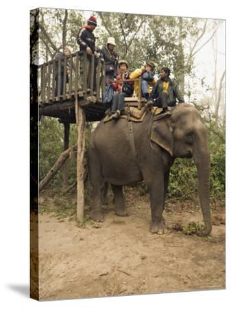 Japanese Tourists Board the Elephant That Will Take Them on Safari-Don Smith-Stretched Canvas Print