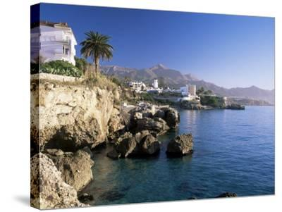 View Along Rocky Coast to Town and Mountains, Nerja, Malaga Area, Costa Del Sol, Andalucia, Spain-Ruth Tomlinson-Stretched Canvas Print
