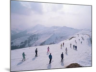 Skiers, Steinberkogel Area, Kitzbuhel, Austria-Adam Woolfitt-Mounted Photographic Print