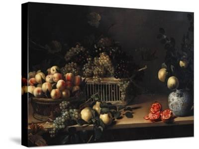 Grapes and Peaches in Wicker Baskets, with Apples, Pears, and Pomegranates on a Table-Cristofano Allori-Stretched Canvas Print