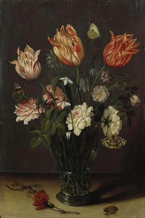 Tulips with Other Flowers in a Glass on a Table-George Wesley Bellows-Stretched Canvas Print