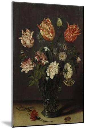Tulips with Other Flowers in a Glass on a Table-George Wesley Bellows-Mounted Giclee Print