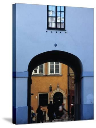 View of Busy Street through an Archway in Stare Miasto, Warsaw, Poland-Izzet Keribar-Stretched Canvas Print