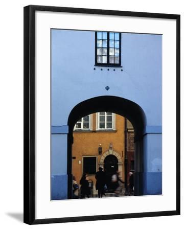 View of Busy Street through an Archway in Stare Miasto, Warsaw, Poland-Izzet Keribar-Framed Photographic Print