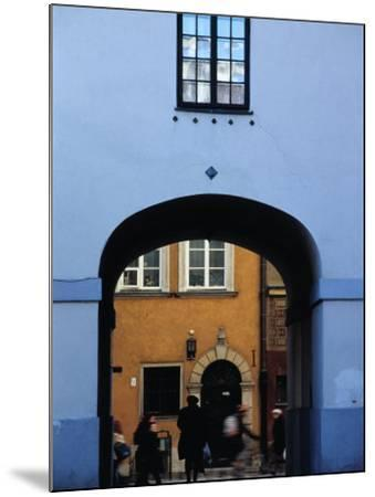 View of Busy Street through an Archway in Stare Miasto, Warsaw, Poland-Izzet Keribar-Mounted Photographic Print