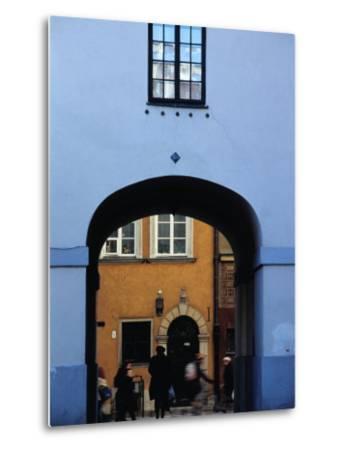 View of Busy Street through an Archway in Stare Miasto, Warsaw, Poland-Izzet Keribar-Metal Print