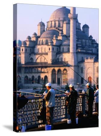 Fishermen on Galata Bridge with Mosque in Background, Istanbul, Turkey-John Elk III-Stretched Canvas Print